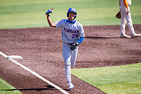 Florida Gators infielder Josh Rivera (24) jogs to home plate against the Tennessee Volunteers on Robert M. Lindsay Field at Lindsey Nelson Stadium on April 11, 2021, in Knoxville, Tennessee. (Danny Parker/Four Seam Images)
