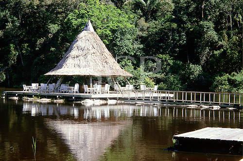 Rio Negro, Amazonas State, Brazil. Bar in an ecotourism reserve owned by the Hotel Tropical with walkways above the water.