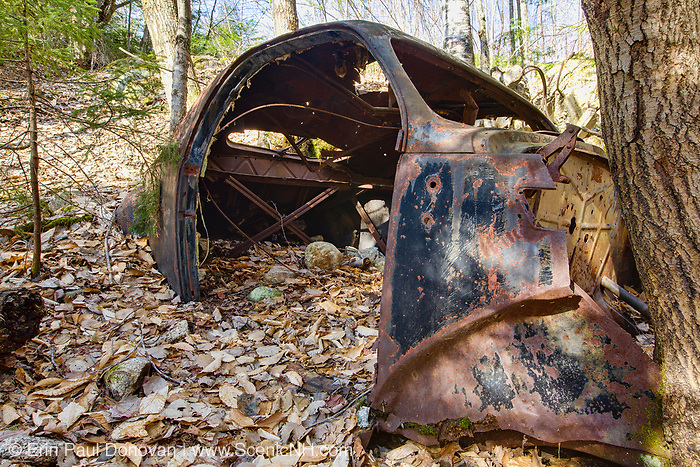 Abandoned old rusted car along Tripoli Road in Waterville Valley, New Hampshire USA.