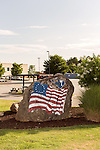 July 6, 2016. Greenville, South Carolina. <br />  The Betsy Ross flag and the symbol of South Carolina are painted on a rock near the GE gas turbine plant outside Greenville, SC.<br />  At the General Electric Gas Turbine factory, engineers  design, produce, test and repair gas turbines for generating electricity. These turbines weigh more than 900,000 pounds and can create internal combustion temperatures up to 2,900 degrees F. Depending on the model, one of the GE turbines can produce enough electricity for half a million American households.