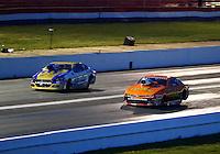 May 16, 2014; Commerce, GA, USA; NHRA pro stock driver Shane Gray (near lane) races alongside Allen Johnson during qualifying for the Southern Nationals at Atlanta Dragway. Mandatory Credit: Mark J. Rebilas-USA TODAY Sports