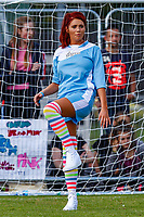 London, UK on Sunday 31st August, 2014. Amy Childs stretches while in goal during the Soccer Six charity celebrity football tournament at Mile End Stadium, London.
