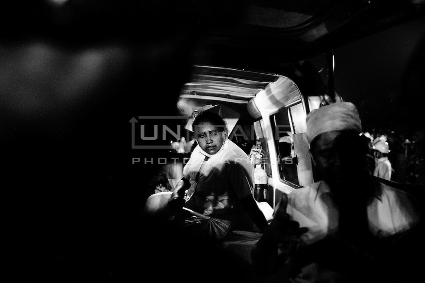 Health worker waits inside of the ambulance as part of its medical service during the rescue operation at the site of Savar tragedy.  Savar, near Dhaka, Bangladesh