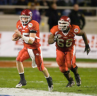 23 December 2006: Utah quarterback Brent Ratliff (#15) runs with the ball during the 2006 Bell Helicopters Armed Forces Bowl between The University of Tulsa and The University of Utah at Amon G. Carter Stadium in Fort Worth, TX.
