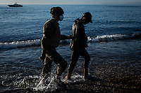 CEUTA, SPAIN ‐ MAY 19: A Spanish soldier accompanies a young migrant who crossed the border between Spain and Morocco by swimming to be returned to Morocco on May 19, 2021 in Ceuta, Spain.  After a diplomatic conflict between Spain and Morocco, thousands of migrants who have taken advantage of the little Moroccan police activity on the border to cross it mainly by swimming, which has caused a migration crisis with the entry of more than 8000 migrants from the African country. (Photo by Joan Amengual/VIEWpress )