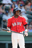 Left fielder Franklin Guzman (10) of the Greenville Drive bats in a game against the Augusta GreenJackets on Sunday, July 13, 2014, at Fluor Field at the West End in Greenville, South Carolina. Greenville won, 8-5. (Tom Priddy/Four Seam Images)