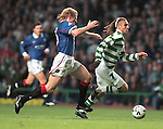 Colin Hendry can't match the pace of Henrik Larsson who slots one in the net for Celtic
