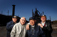 """BETHLEHEM STEEL : From left  AL Check worked in the foundry 42 years, George Check worked in the blast furnace 40 years, Frank Check, worked in the blast furnace 42 years and  Richie Check, worked as a riger for exactly 43 years 5 months and  15 days. The last 4 left of 9 borthers they pose in front of Blast Funace  E, where their photo along with the other 5 brothers who have since died was taken some 50 years ago. Emil, Frank and Richie. Of the 9 only Bartholomew, George, Frank and Richie are still alive. These nine along with their dad, sister and 2 sons worked a total of 441 years in the bethlehem Plant. Say Richie """" I never thought in my wildest dreams this would even happen, refering to the closing, bankruptcy and sale. I always heard they were ranked #2, but they were #1 in my book."""" ( CHUCK ZOVKO / TMC)"""
