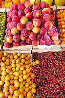 Fresh peaches, apricots & cherries on a fruit market stall, Syros, Greece