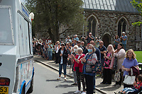BNPS.co.uk (01202) 558833<br /> Pic: Zachary Culpin/BNPS<br /> <br /> Pictured: People line the streets to to pay their respects.<br /> <br /> A much-loved ice cream seller was given a fitting send off by colleagues who followed his funeral cortege in a convoy of 10 ice cream vans. <br /> <br /> John Lennie spent over 40 years selling ice creams from his trusty van in his local community.<br /> <br /> So dedicated was he to his job that he was still doing his rounds just two days before he died at the age of 79.<br /> <br /> His daughter, Jemma Lennie, led the procession in her father's old colourful truck at his funeral in Wimborne, Dorset.