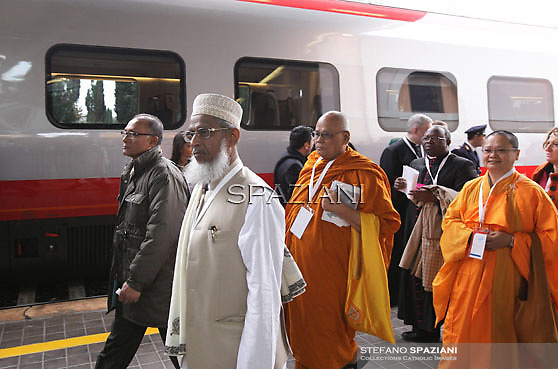 """Some of the 300 religious dignitaries disembark from the train upon arrival at Assisi station to attend the interreligious talks on October 27, 2011. Pope Benedict XVI will lead during the day the 25th Interreligious talks, a """"journey of reflection, dialogue and prayer for peace and justice in the world"""" held in St. Francis of Assisi's birthplace,"""