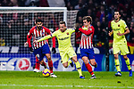 Arthur Melo of FC Barcelona (C) fights for the ball with Antoine Griezmann of Atletico de Madrid (R) during the La Liga 2018-19 match between Atletico Madrid and FC Barcelona at Wanda Metropolitano on November 24 2018 in Madrid, Spain. Photo by Diego Souto / Power Sport Images