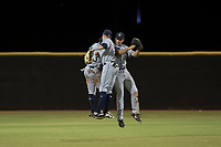 AZL Padres 1 outfielder Greg Lambert (14), Jawuan Harris (13), and Agustin Ruiz (24) celebrate a win after an Arizona League game against the AZL Padres 2 at Peoria Sports Complex on July 14, 2018 in Peoria, Arizona. The AZL Padres 1 defeated the AZL Padres 2 4-0. (Zachary Lucy/Four Seam Images)