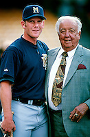 Geoff Jenkins of the Milwaukee Brewers poses with former USC Trojans baseball coach Rod Dedeaux before a Major League Baseball game at Dodger Stadium during the 1998 season in Los Angeles, California. (Larry Goren/Four Seam Images)