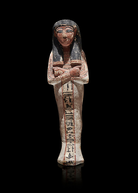 Ancient Egyptian shabtis doll, lwood, New Kingdom, 18th Dynasty, (1538-1040 BC), Deir el Medina. Egyptian Museum, Turin. black background <br /> <br /> shabti figures began to occur in Middle Kingdom tombs with a twofold nature: on <br /> the one hand, they were meant to be images of their owners, representatives of the deceased in the realm of the Lord of Eternity. <br /> On the other hand, they were also considered to be servants of the deceased, taking the role of the servant statues. The complex <br /> nature of the shabti figure as a substitute of both the owner and his or her servants remains unaltered during the New Kingdom