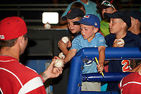 A group of young fans gets Batavia Muckdogs players autographs after a game against the Brooklyn Cyclones on July 6, 2016 at Dwyer Stadium in Batavia, New York.  Batavia defeated Brooklyn 15-2.  (Mike Janes/Four Seam Images)