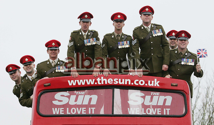 "The Sun bus with  The ""Light Dragoons"" as they march through the town centre of East Derham on their return from Afghanistan"
