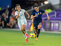 ORLANDO, FL - FEBRUARY 24: Christen Press #23 of the USWNT dribbles during a game between Argentina and USWNT at Exploria Stadium on February 24, 2021 in Orlando, Florida.