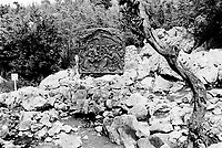 Bosnia. Medjugorje. Podbrdo, also called the Apparition Hill, is the place above the village of Bijakovici near Medjugorje where the six visonaries in the first days saw the Virgin Mary. Since then it is here that the pilgrims gather for prayer of the rosary. In 1989, the reliefs of the joyful and sorrowful mysteries of the rosary were placed along the path. © 2002 Didier Ruef