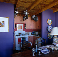 A compact kitchen is situated in a recessed area of the dining room