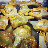close up of frying artichokes