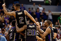 Isaiah Thomas is raised up by teammates after the win. The Washington Huskies defeated the California Golden Bears 79-75 during the championship game of the Pacific Life Pac-10 Conference Tournament at Staples Center in Los Angeles, California on March 13th, 2010.