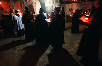 Overview of monks and pilgrims in the Armenian Orthodox Church of the Sepulchre. Jerusalem, Israel.