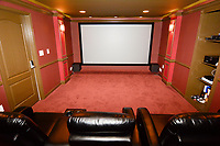 Home theaters and other luxury amenities can help you bring top dollar for your property--if people see a good photo in your listing.