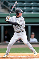 Shortstop Daniel Ficas (26) of the USC Upstate Spartans bats in a game against the Furman University Paladins on Tuesday, March 4, 2013, at Fluor Field at the West End in Greenville, South Carolina. Furman won, 13-1. (Tom Priddy/Four Seam Images)