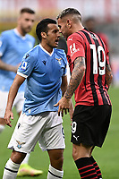 Pedro Rodriguez Ledesma of SS Lazio argues with Theo Hernandez of AC Milan during the Serie A 2021/2022 football match between AC Milan and SS Lazio at Giuseppe Meazza stadium in Milano (Italy), August 29th, 2021. Photo Image Sport / Insidefoto