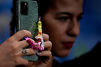 A girl takes pictures with her mobile phone during the Qatar 2022 world cup qualifying football match between Italy and Lithuania at Citta del tricolore stadium in Reggio Emilia (Italy), September 8th, 2021. Photo Andrea Staccioli / Insidefoto