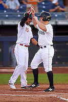 Peoria Javelinas outfielder Tyler O'Neill (4) high fives Alex Blandino (15) after hitting a walk off home run during an Arizona Fall League game against the Mesa Solar Sox on October 21, 2015 at Peoria Stadium in Peoria, Arizona.  Peoria defeated Mesa 5-3.  (Mike Janes/Four Seam Images)