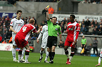 ATTENTION SPORTS PICTURE DESK<br /> Pictured: Nicky Bailey (4) protesting for the yellow card shown by referee K Stroud (C) for his foul against Jordi Gomez of Swansea  (not pictured.<br /> Re: Coca Cola Championship, Swansea City FC v Charlton Athletic at the Liberty Stadium, Swansea, south Wales. 28 February 2009<br /> Picture by D Legakis Photography / Athena Picture Agency, Swansea 07815441513