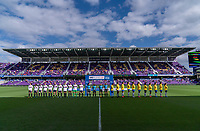 ORLANDO, FL - FEBRUARY 21: The USWNT and Brazil line up before a game between Brazil and USWNT at Exploria Stadium on February 21, 2021 in Orlando, Florida.