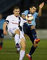 Ayr Utd's Alan Lithgow clears from Forfar's Dale Hilson.