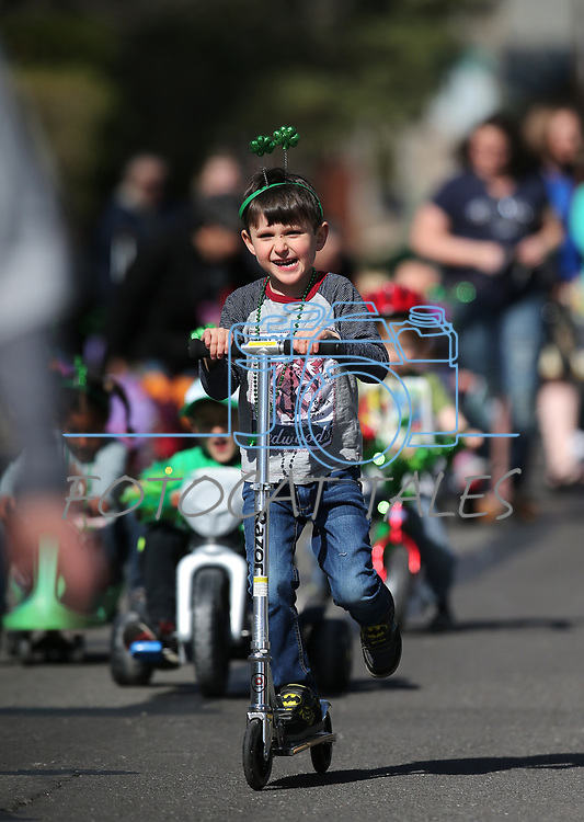 Families participate in the Kinderland Nursery School's St. Patrick's Day/spring celebration parade in Carson City, Nev., on Friday, April 13, 2018. Snow in March postponed the original parade. <br /> Photo by Cathleen Allison/Nevada Momentum