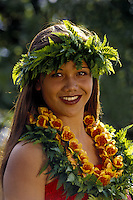 Portrait of a hula dancer in traditonal ferns and a ilima lei in Kihei, Maui.