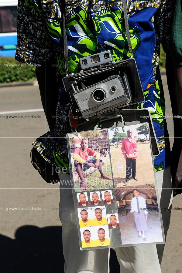 ZAMBIA, Lusaka city center, Cairo Road, street photographer with old Polaroid camera automatic 355
