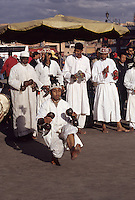 Marrakesh, Morocco - Gnaoua Musicians and Dancers, Place Jemaa El-Fna.  Cowrie Shell Decorations on Caps.  The metal castanets are called qarqaba.