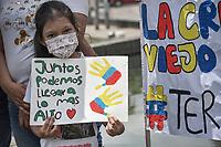 """CALI - COLOMBIA, 08-05-2021: Un niña porta un cartel que dice """"Juntos podemos llegar a lo más alto"""" durante la misa en la glorieta de La Portada en donde manifestantes y habitantes del sector en Cali Colombia se congregaron hoy, 09 mayo de 2021, durante el doceavo día de protestas del Paro Nacional convocado por la reforma tributaria y de la salud que adelanta el gobierno de Ivan Duque además de la precaria situación social y económica que vive Colombia. Durante el día se presentaron bloqueos intermitentes y además recibieron el apoyo de la Minga Indígena. El paro fue convocado por sindicatos, organizaciones sociales, estudiantes y la oposición y sumando el día del trabajo lleva 11 días de marchas y protestas. / A girl carries a sign that says """"Together we can reach the top"""" during a mass in the roundabout of La Portada where protesters and inhabitants of the sector in Cali Colombia gathered today, May 09, 2021, during the twelfth day of protests of the National Strike called for the tax and health reform carried out by the government of Ivan Duque in addition to the precarious situation social and economic life in Colombia. During the day there were intermittent blockades and they also received the support of the Indigenous Minga. The strike was called by unions, social organizations, students and the opposition and adding up to Labor Day it has been 11 days of marches and protests. Photos: VizzorImage / Gabriel Aponte / Staff"""