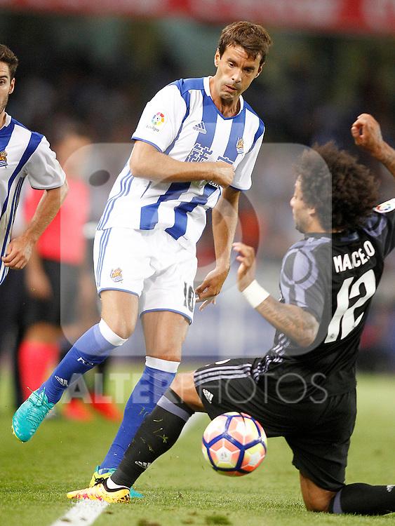 Real Sociedad's Xabi Prieto (l) and Real Madrid's Marcelo Vieira during La Liga match. August 21,2016. (ALTERPHOTOS/Acero)