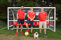 """COPY BY TOM BEDFORD<br /> Pictured: Matt Evans (C) with friends in his back garden at his house in south Wales, UK<br /> Re: A soccer-mad lottery millionaire has splashed out on his own football pitch complete with a dug-out on the touchline.<br /> Former postman Matt Evans 37, turned his back garden into a mini soccer stadium so his mates can come for a kick about.<br /> The super-rich bachelor is blowing his fortune on his love for the beautiful game.<br /> He said: """"I'm living the dream by having my own pitch with lifesize goals and all the white markings.<br /> """"I invite my old workmates around for a game and we sit in the dugout to talk about football.<br /> """"My dad comes along for a game but we usually ask him to play in goal.""""<br /> Matt was a £300-a-week postman three years ago using jumpers for goalposts in his local park.<br /> But after a lottery lucky dip netted him £2,604,015 he's living the life of a Premiership soccer star."""