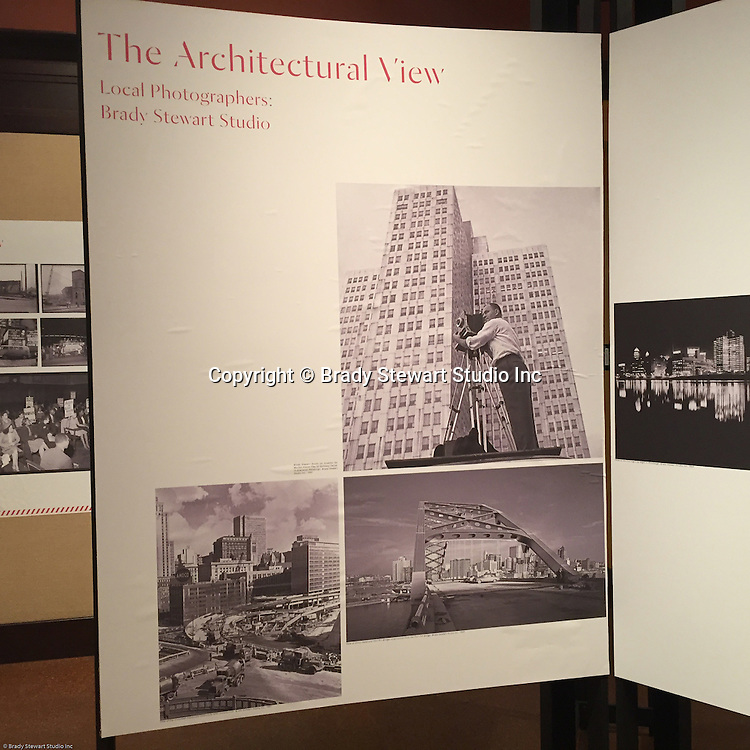 Pittsburgh PA:  View of the architectural view area of the Imaging for Modern exhibition inside the Carnegie Museum of Art.  View of Brady Stewart Jr. on an assignment for Ketchum McLeod and Grove in the new Gateway Center. Photographs from the Brady Stewart Studio Archives were used in the exhibition about Pittsburgh's architectural evolution 1945-1970.<br /> The images were selected by the consultant's Over Under due to the quality and the unique city views.  From 1945 to 1970 Brady Stewart Studio was the largest commercial photography studio in western Pennsylvania.<br /> The Exhibition runs from September 1915 thru May 2016.  Press release can be found at the following internet address; http://press.cmoa.org/2015/05/27/hac-lab-pittsburgh/.