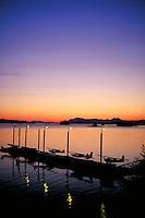 Seaplanes docked at sunset, Alaska, AK