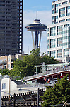 The Space Needle tucked between two buildings in Seattle, WA. on May 20th, 2019.