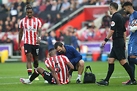 Ethan Pinnock of Brentford receives treatment after suffering an injury during Brentford vs Liverpool, Premier League Football at the Brentford Community Stadium on 25th September 2021
