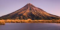 Taranaki, Mt. Egmont 2518m, living volcano with alpine tarn at twilight, Egmont National Park, North Island, New Zealand, NZ