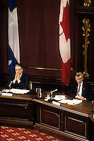 1990 File Photo - Quebec (Qc) CANADA :  Michel Belanger (L) and Jean Campeau (R)  at the Belanger-Campeau Commission hearing in the National Assembly Salon Rouge.<br /> <br /> <br /> Belanger-Campeau Commission' (formally known as the Commission on the Political and Constitutional Future of Quebec), on the initiative of Premier Robert Bourassa. Its mandate was to examine the political and constitutional status of Quebec and to make recommendations for change in a report to the National Assembly no later than 28 March 1991. Its work proceeded concurrently with, but was entirely separate from, that of the Quebec Liberal Party's constitutional committee headed by Jean Allaire (see Allaire Report).