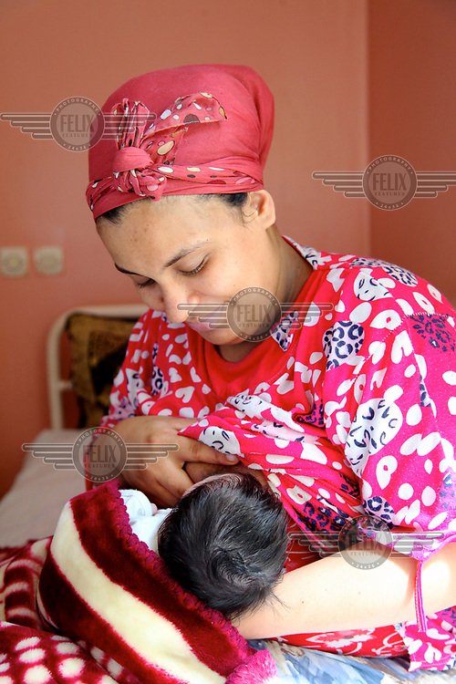 A mother breastfeeds her baby in the neonatology unit at the Ghassani Hospital.