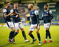 29th December 2020; Dens Park, Dundee, Scotland; Scottish Championship Football, Dundee FC versus Alloa Athletic; Liam Fontaine of Dundee celebrates after scoring for 2-1 with Jordan McGhee, Lee Ashcroft and Declan McDaid
